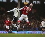 Fulham defender Ryan Fredericks (07) fouling Charlton Athletic striker, Simon Makienok (9) in the air during the Sky Bet Championship match between Fulham and Charlton Athletic at Craven Cottage, London, England on 20 February 2016. Photo by Matthew Redman.