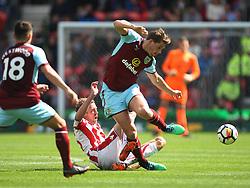 Peter Crouch of Stoke City (C) tackles James Tarkowski of Burnley (R) - Mandatory by-line: Jack Phillips/JMP - 22/04/2018 - FOOTBALL - Bet365 Stadium - Stoke-on-Trent, England - Stoke City v Burnley - English Premier League