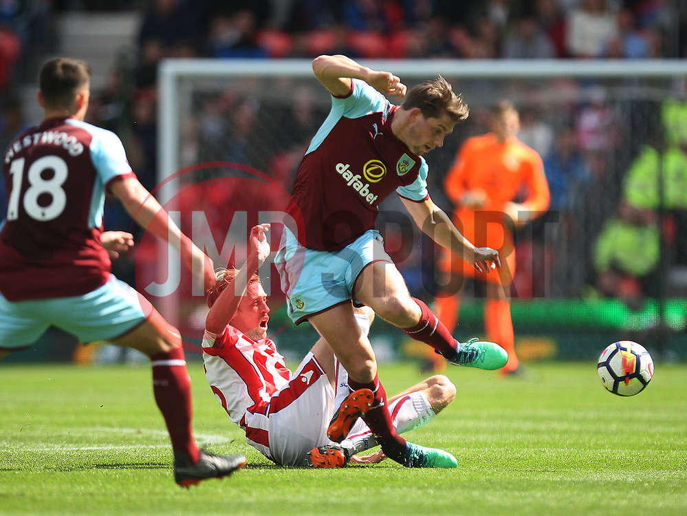 Peter Crouch of Stoke City (C) tackles James Tarkowski of Burnley (R) - Mandatory by-line: Jack Phillips/JMP - 22/04/2018 - FOOTBALL - Bet365 Stadium - Stoke-on-Trent, England - Stoke City v Burnley - English Premier League