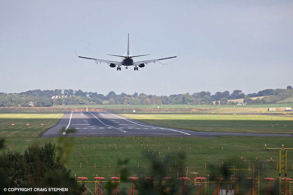 A plane landing at Edinburgh airport, Scotland, UK