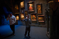 "Hans Iselborn, 9, and his father Daniel Iselborn listen to their audio tour as they enter the ""Harry Potter"" exhibition at Discovery Times in New York. ..Photo by Robert Caplin."
