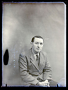 vintage portrait of an adult man in suit France, circa 1930s