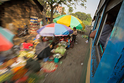 Asia, Myanmar, Burma, Yangon, vegetable sellers below moving train