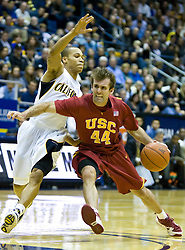 January 9, 2010; Berkeley, CA, USA;  Southern California Trojans guard Mike Gerrity (44) is guarded by California Golden Bears guard Jerome Randle (3) during the second half at the Haas Pavilion.  California defeated USC 67-59.