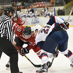WELLINGTON, - Dec 11, 2015 -  Exhibition Game 2- Team USA vs Team Canada East at the 2015 World Junior A Challenge at the Wellington District Community Centre, ON. Tyler Rollo #18 of Team Canada East takes face-off against Ross Colton #22 of Team United States during the second period.<br /> (Photo: Andy Corneau / OJHL Images)