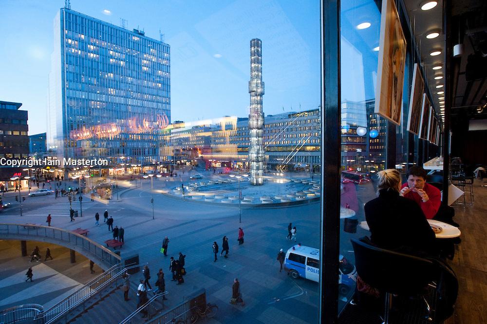 View of Sergels Torg square at dusk from inside Kulturhuset building in central Stockholm Sweden 2009