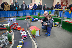 © Licensed to London News Pictures. 17/01/2020. London, UK. A child with a remote control drives a building truck at the London Model Engineering Exhibition at Alexandra Palace.<br /> Enthusiasts and hobbyists visit the annual London Model Engineering Exhibition at Alexandra Palace in north London. Clubs and societies are exhibiting spectrum of modelling from traditional model engineering, steam locomotives and traction engines through to the more modern gadgets including trucks, boats, aeroplanes and helicopters with nearly 2,000 models constructed by their members. <br /> <br /> *** Permission Granted***<br /> <br /> Photo credit: Dinendra Haria/LNP