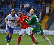 Coventry City Striker, Adam Armstrong causes some issues in the box fro Bury Goalkeeper Robert Lainton during the Sky Bet League 1 match between Bury and Coventry City at Gigg Lane, Bury, England on 26 September 2015. Photo by Mark Pollitt.