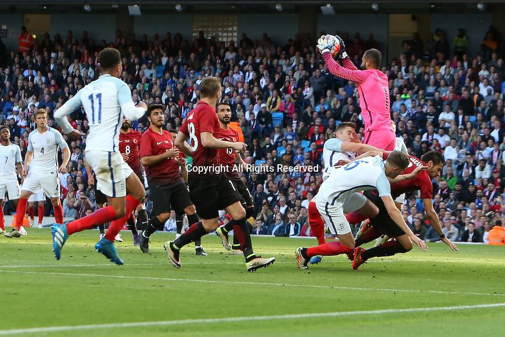 22.05.2016. Etihad Stadium, Manchester, England. International football friendly match, England versus Turkey. Volkan Barbican of Turkey claims a cross under pressure from Gary Cahill of England.