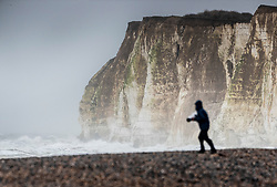 © Licensed to London News Pictures. 14/01/2020. Newhaven, UK. High tides and strong winds bring huge waves onto the cliffs near the entrance to Newhaven harbour in East Sussex. The effects of storm Brendan are still being felt throughout the UK. Photo credit: Peter Macdiarmid/LNP