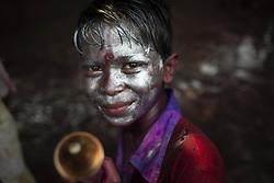 March 22, 2019 - Narayanganj, Narayanganj Sadar, Bangladesh - A boy with a coloured face seen posing for a photo during the celebration..Holi known as the festival of colour is an ancient Hindu spring festival which is now celebrated in many countries and Bangladesh is among those. People arrange many dancing programs and play with colour, powder and water to express and share their happiness with each other. (Credit Image: © Ziaul Haque Oisharjh/SOPA Images via ZUMA Wire)