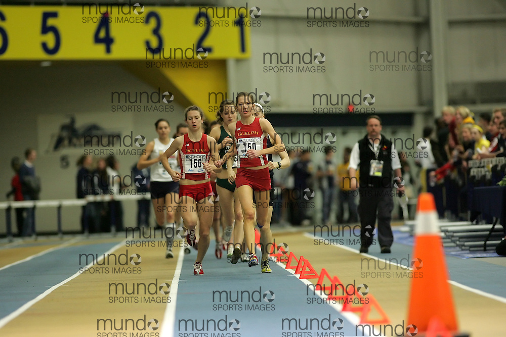 (Windsor, Ontario---12 March 2010) Genevieve Lalonde of University of Guelph Gryphons   Rachel Cliff of University of Guelph Gryphons   competes in the 3000m final at the 2010 Canadian Interuniversity Sport Track and Field Championships at the St. Denis Center. Photograph copyright Sean Burges/Mundo Sport Images. www.mundosportimages.com