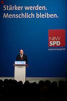"""09 APR 2005 DORTMUND/GERMANY:<br /> Peer Steinbrueck, SPD, Ministerpraesident, waehrend seiner Rede, unter dem Motto """"Staerker werden. Menschlich bleiben."""",  Wahlkampfauftaktveranstaltung zur Landtagswahl in Nordrhein-Westfalen, Westfalenhalle<br /> IMAGE: 20050409-02-022<br /> KEYWORDS:Peer Steinbrück, speech"""