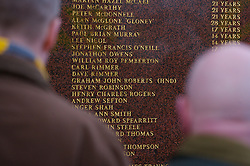 LIVERPOOL, ENGLAND - Saturday, January 26, 2008: Liverpool supporters stop to read the names of the victims of the Hillsborough Disaster on a memorial outside Liverpool FC's Anfield Stadium. 96 supporters lost their lives in Britain's worst ever sporting disaster. (Photo by David Rawcliffe/Propaganda)