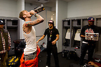 Rapper Machine Gun Kelly takes a swig of Jack Daniels before taking the stage for the MMG Tour stop in, Providence, Rhode Island at the Dunkin Donuts Center on November, 16, 2012.  Photo by Matthew Healey