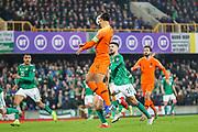 Netherlands defender Virgil van Dijk (4) climbs to head the ball across goal during the UEFA European 2020 Qualifier match between Northern Ireland and Netherlands at National Football Stadium, Windsor Park, Northern Ireland on 16 November 2019.