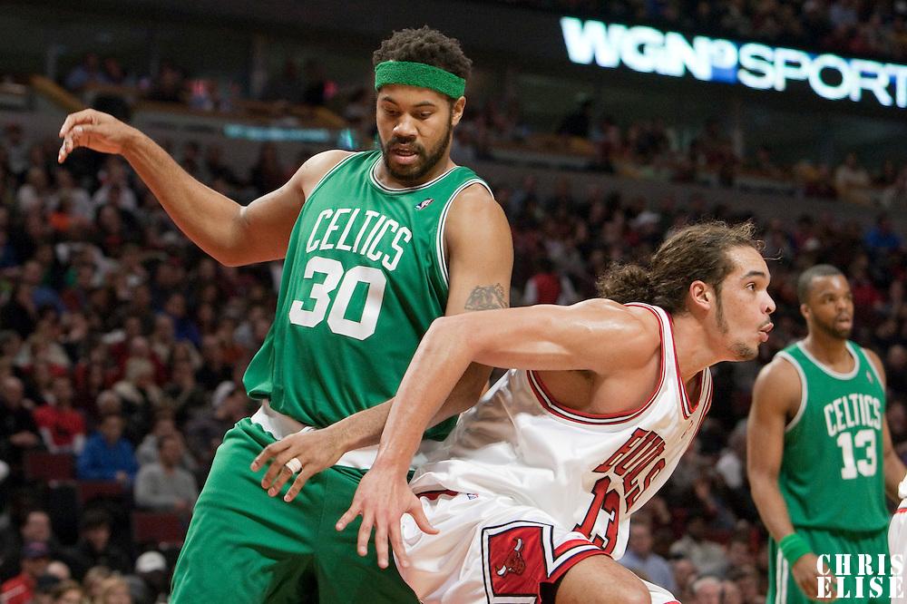 12 December 2009: Chicago Bulls center Joakim Noah defends against Boston Celtics center Rasheed Wallace during the Boston Celtics 106-80 win over the Chicago Bulls at the United Center, in Chicago, Illinois, USA.