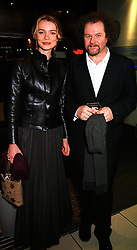 Film director MIKE FIGGIS and partner actress SAFFRON BURROWS, at a film premier in London on 11th January 2000.OAB 124