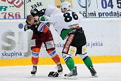 Fight between Jure Stopar (HDD Tilia Olimpija, #86) and Jure Dolinsek (HK Acroni Jesenice, #22) during ice-hockey match between HK Acroni Jesenice and HDD Tilia Olimpija in fourth game of Final at Slovenian National League, on April 8, 2011 at Dvorana Podmezaklja, Jesenice, Slovenia. (Photo By Matic Klansek Velej / Sportida.com)
