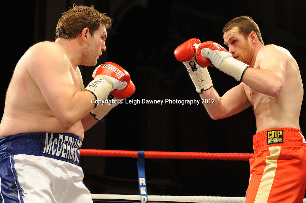 David Price (red shorts) defeats John McDermott in 12x3 min contest to claim The British Heavyweight Title Eliminator at Olympia, Liverpool on the 21st January 2012. Referee Howard John Foster. Frank Maloney Promotions on Skysports HD1. © Leigh Dawney Photography 2012.