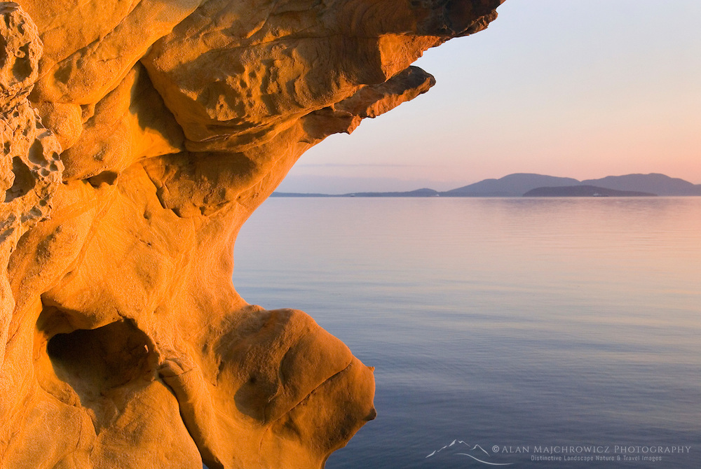 Evening light on sandstone formations of Larrabee State Park Washington. In the distance are the San Juan Islands.