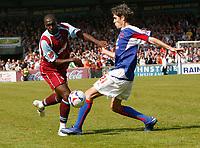 Photo: Steve Bond.<br />Scunthorpe United v Carlisle United. Coca Cola League 1. 05/05/2007. Cleveland Taylor (L) goes past Zigor Aranalde (R)