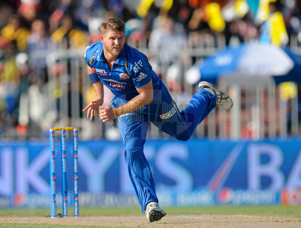 Corey Anderson of the Mumbai Indians bowls during match 16 of the Pepsi Indian Premier League 2014 between the Delhi Daredevils and the Mumbai Indians held at the Sharjah Cricket Stadium, Sharjah, United Arab Emirates on the 27th April 2014<br /> <br /> Photo by Pal Pillai / IPL / SPORTZPICS