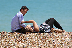 © Licensed to London News Pictures. 08/07/2014. Brighton, UK. People sunbathing on Brighton beach. Temperatures in the next weeks are expected to soar to 86F around the UK with the South Coast predicted to hit record according to the MET. Photo credit : Hugo Michiels/LNP