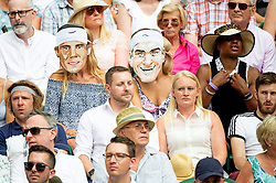 © Licensed to London News Pictures. 09/07/2018. London, UK. Spectators wear masks depicting Rafael Nadal and Roger Federer on the centre court during the Wimbledon Tennis Championships 2018, at the All England Lawn Tennis and Croquet Club. Photo credit: Ray Tang/LNP