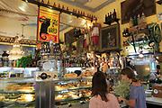 Customer inside famous historic Los Gatos Cervecerias bar, Madrid city centre, Spain