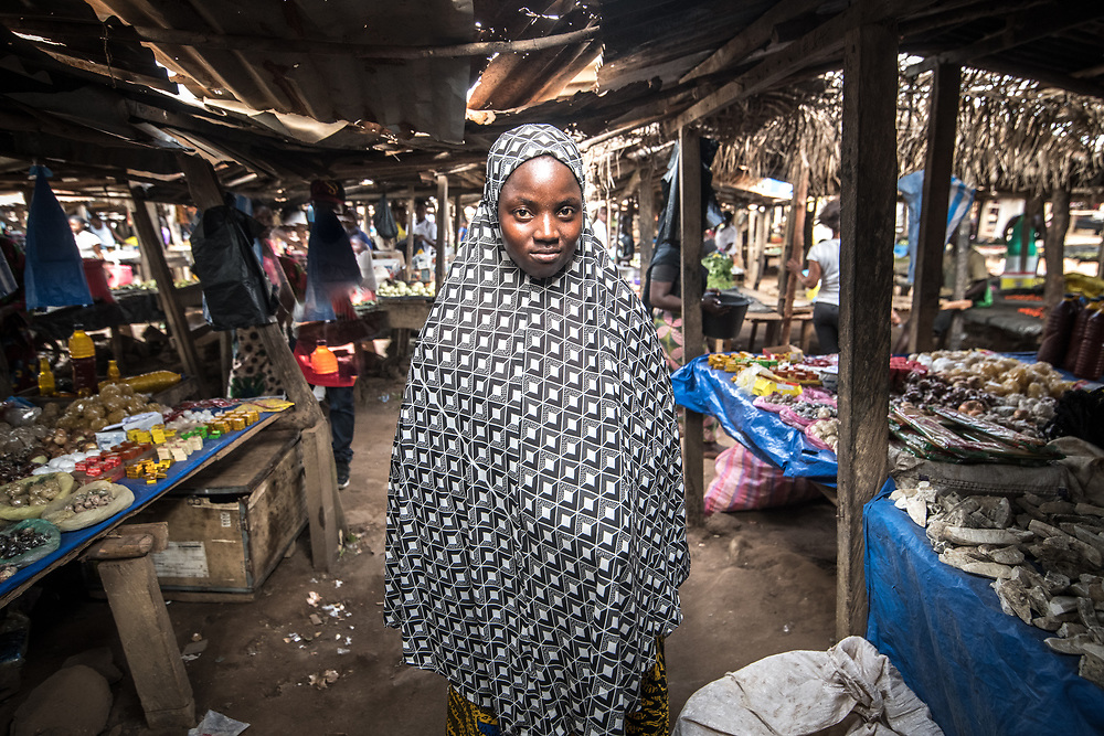 A woman poses in the market  in Ganta, Liberia