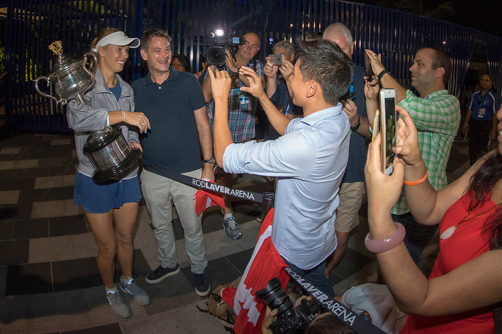 Caroline Wozniacki of Denmark greets fans after winning the women's singles championship match during the 2018 Australian Open on day 13 in Melbourne, Australia on Saturday night January 27, 2018.<br /> (Ben Solomon/Tennis Australia)