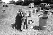 The artist Hank painting a board. Glastonbury,Somerset.1989.
