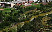 Discoloration of the Animas River can be seen as it flows adjacent to Durango High School in the heart of Durango, Colorado.