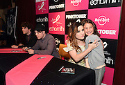 Echosmith's lead vocalist, Sydney Sierota, hugs a fan at Hard Rock Cafe New York during the launch of Hard Rock International's 16th annual breast cancer awareness campaign benefiting the Breast Cancer Research Foundation on Monday, September 14, 2015.  (Photo by Diane Bondareff/Invision for Hard Rock International)