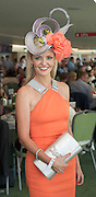 30/07/2014 Annemarie McManus (JP&rsquo;s daughter-in-law) from Ballsbridge who won the Lydon House  Catering event &ldquo;Handbags, Hat and Heels&rdquo; competition on the top floor of the Killlanin Stand at the Galway Racecourse sponsored by PIA Boutique. <br /> Annemarie said &quot;I&rsquo;m estatic and delighted and I&rsquo;ll be in to Pia tomorrow&quot;. <br /> Annemarie wore a Irish Milliner headpiece by Niamh Reilly and aYSL Handbag and shoes by Louboutin. Photo:Andrew Downes