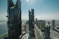 09 APR 2013, DOHA/QATAR<br /> Suedlicher Teil von Downtown Doha mit den zwei Tuermen der Palm Towers (links), aus dem Büro der Qatar Foundation im Tornado Tower<br /> IMAGE: 20130409-01-028<br /> KEYWORDS: Katar, Skyline, Skyscrapers, Wolkenkratzer