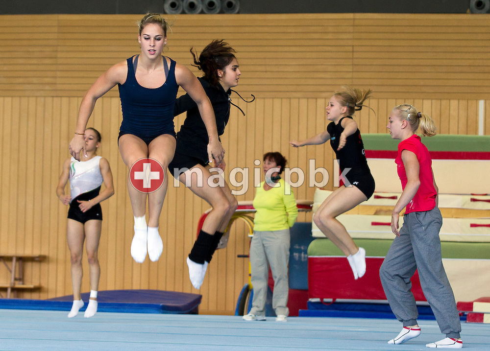 Artistic gymnastics athlete Giulia STEINGRUBER (2nd L) of Switzerland and her teammates are pictured during a training session in a gym at the Federal College of Sports Magglingen in Magglingen in the canton of Berne, Switzerland, Monday, Aug. 29, 2011. (Photo by Patrick B. Kraemer / MAGICPBK)