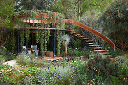 Belvedere in the Winton Beauty of Mathematics Garden, Chelsea Flower Show 2016. Mathematical symbols cut into band of copper used as bannister for staircase. Pinus sylvestris 'Glauca' (blue Scot's pine),Yucca rostrata (Beaked Yucca)
