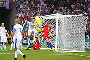 Slovakia Goalkeeper Matus Kozacik collects the ball from England Forward Jamie Vardy during the Euro 2016 Group B match between Slovakia and England at Stade Geoffroy Guichard, Saint-Etienne, France on 20 June 2016. Photo by Phil Duncan.