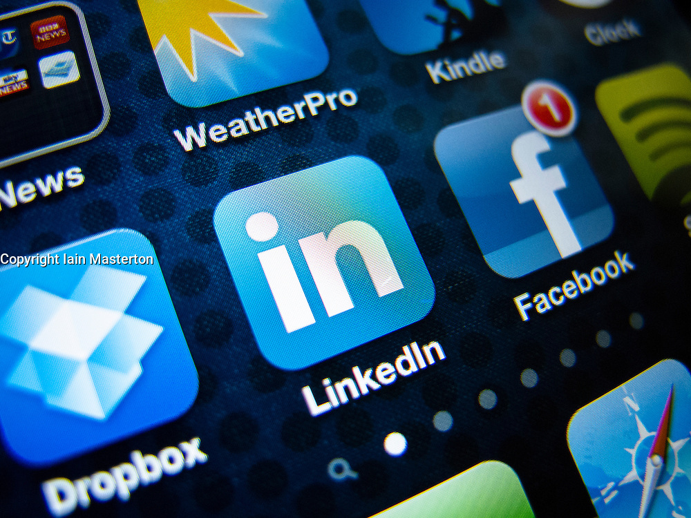 detail of iPhone 4G screen showing LinkedIn professional social networking app