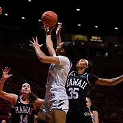 09 November 2018: San Diego State Aztecs guard Kennedi Villa (0) lays the ball up for two points past Hawaii Warriors forward Makenna Woodfolk (35) in the first quarter. The Aztecs opened up it's regular season schedule with a 58-57 win over Hawaii Friday at Viejas Arena.