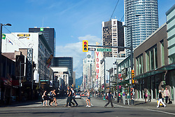 Pedestrians cross the intersection of Nelson Street and Granville Street, Vancouver, British Columbia, Canada