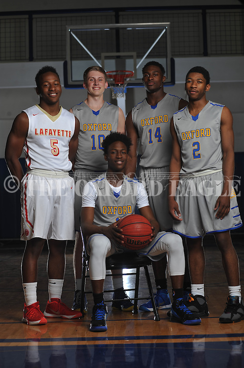 The Oxford Eagle's All-Area Basketball Team for 2015-16 is, sitting, Oxford High's Jarkel Joiner, player of the year, and standing, from left, Lafayette High's Quin Jones, Oxford High's Cole Cromwell, Oxford High's DK Metcalf, and Oxford High's Terry Williams, in Oxford, Miss. on Tuesday, April 5, 2016.