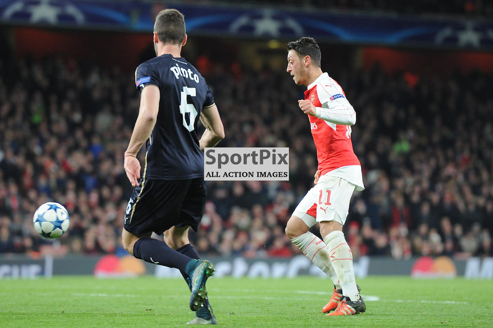 Arsenals Mesut Ozil and Dinamo Zagrebs Ivo Pinto in action during the Arsenal v Dinamo Zagreb game in the UEFA Champions League on the 24th November 2015 at the Emirates Stadium.