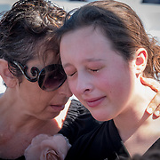 THURSDAY, FEBRUARY 15- 2018---CORAL SPRINGS, FLORIDA--<br /> Sabrina, left, and Coco Bentaieb Cozzolino during community prayer vigil at Parkridge Church for  Marjory Stoneman Douglass High School shooting one day after a mass shooting with 17 casualties.<br /> (Photo by Angel Valentin/FREELANCE)