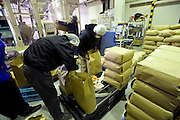 Signs of recovery in Miyagi Prefecture, Japan on 01 Dec., 2011. .Photographer: Robert GilhoolyEmployees package rice at a facility belonging to Butai Farm in Sendai, Japan on December 01, 2011.  The company was established as Butai Farm in 2003 with the idea of developing a company that would work on the whole farming process -- from production to processing, distribution, and sales. The March 11 tsunami flooded about 60% of the company's 40-hectare farmland. While working toward the reconstruction of the land, they have also introduced a three-tier radiation testing system in an attempt to recover consumer confidence..Photographer: Robert Gilhooly