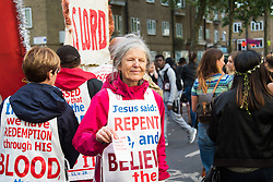 London, August 28th 2016. Evangelists preach their message of salvation to the crowds during Family Day at Europe's biggest street party, the Notting Hill Carnival.