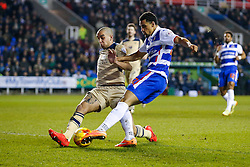 Nick Blackman of Reading shoots as Giuseppe Bellusci of Leeds United challenges - Photo mandatory by-line: Rogan Thomson/JMP - 07966 386802 - 10/02/2015 - SPORT - FOOTBALL - Reading, England - Madejski Stadium - Reading v Leeds United - Sky Bet Championship.