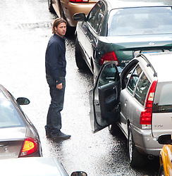 """A police motorbike smashes the wing mirror of the car carrying Brad Pitt on the set of the movie """"World War Z"""" being shot in the city centre of Glasgow. The film, which is set in Philadelphia, is being shot in various parts of Glasgow, transforming it to shoot the post apocalyptic zombie film."""
